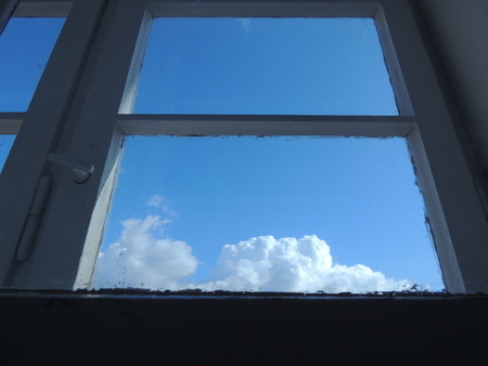 Looking Through Old Window At The Sky