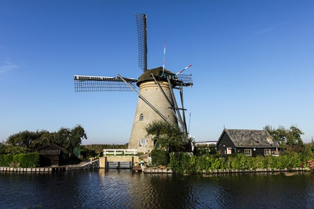 Windmill with house photo