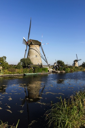Windmills on the river photo