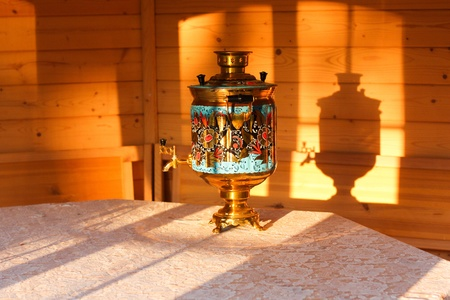 Grandma s old samovar at sunset  photo