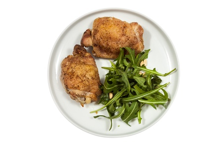 part frog: Roast Chicken with rucola on a plate  Stock Photo