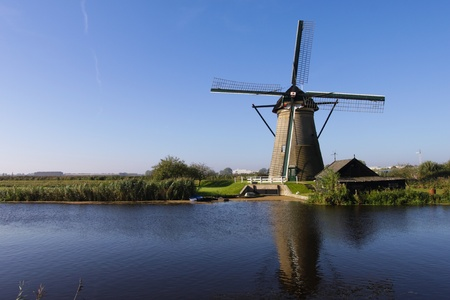 Windmill with house in Holland photo