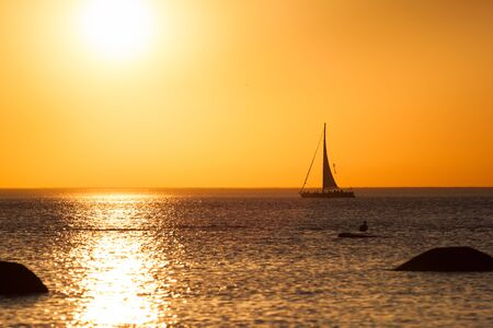 Photo of a yacht silhouette during sunset photo