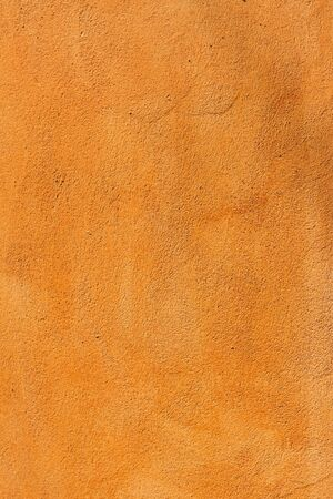 parget: Orange plaster wall with old texture