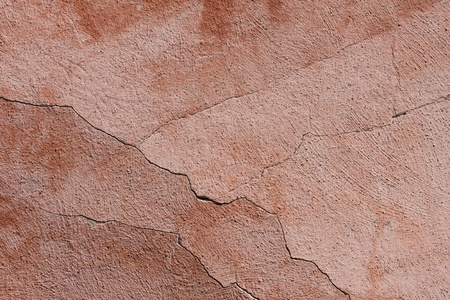 Cracked pink old wall texture background photo