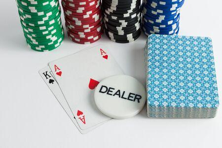 holdem: Casino cards chips and dealer over white