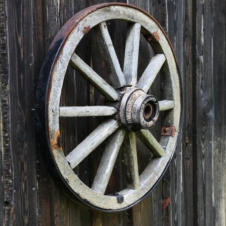 old wood farm wagon: Old cart wheel