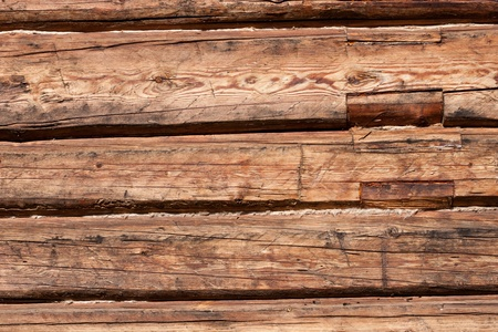 Wooden timber wall of old house photo