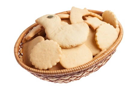Basket of homemade cookies isolated on white background photo