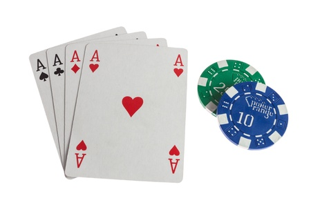 Four aces casino cards with chips isolated on white background photo