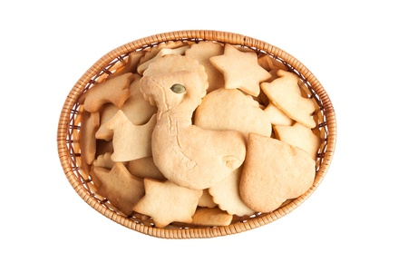 Basket of homemade biscuit cookies with bird, heart. star, horse cookies isolated on white background photo