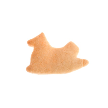 Horse shape homemade cookie isolated on white background made by a child photo