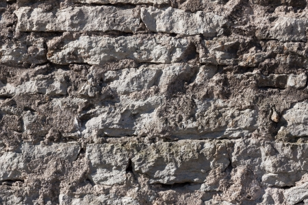 Old stone brick wall of a house photo
