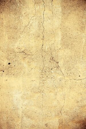 Cool vintage yellow concrete wall background texture photo