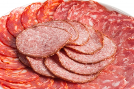 Chorizo, salchichon and salami sausage on a plate isolated over white background 2 photo