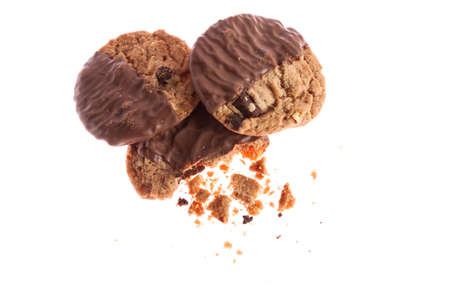 missing bite: Chocolate cookies with crumbs isolated on white 2 Stock Photo