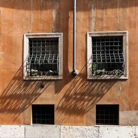 Vintage window and Rain Water Tube, Italy Stock Photo - 13786260