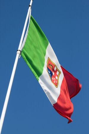 Italian flag over blue sky Stock Photo - 13900746