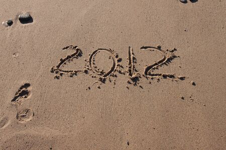 Numbers 2012 on the beach sand photo
