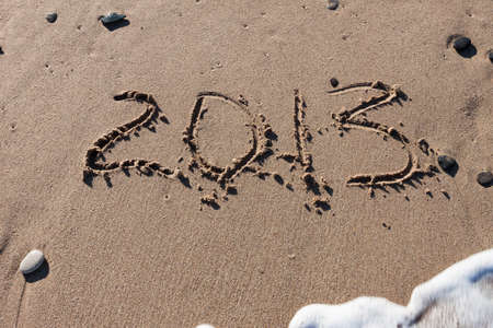 Numbers 2013 on the beach sand Stock Photo - 14230269