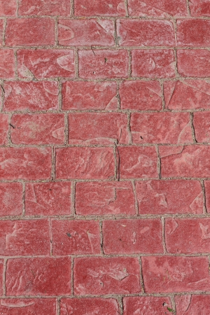 Seamless tile pattern of a red cobble stone street texture or background photo