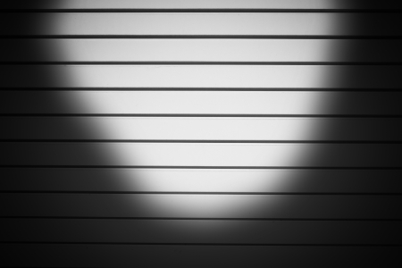 industrial white metal door background with dark corners photo