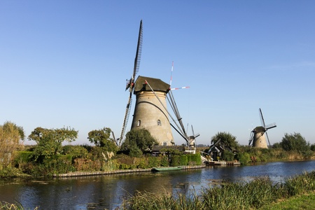 Kinderdijk Windmills in The Netherlands near river photo