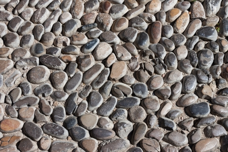 Pebbles stone road texture background photo