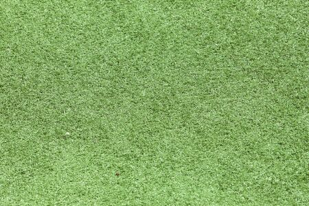 Artificial grass field top side view texture background photo