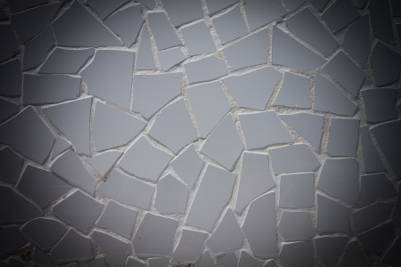 White tile pattern of a cobble stone street texture  with dark edges photo