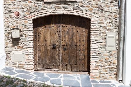 old wooden door in Catalonia, Spain photo