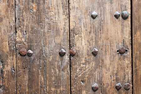 Big brown wooden door background with diagonal pattern photo