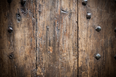 Brown wooden door background with nails photo