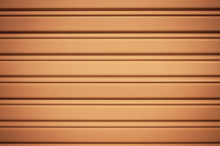 Cool industrial metal orange door background with dark corners