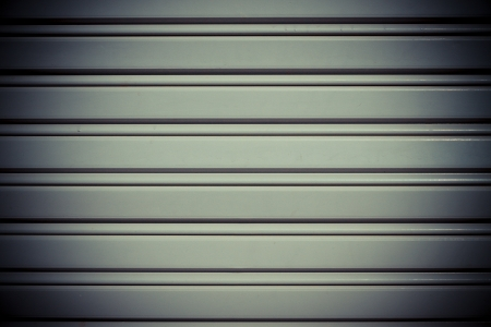 Cool industrial metal gray door background with dark corners