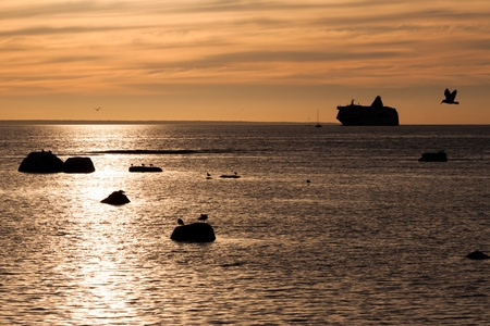 Cruise lliner in sunset in sea photo