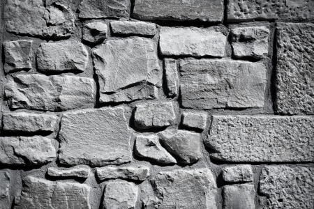 Cool vintage black and white stone wall texture background photo