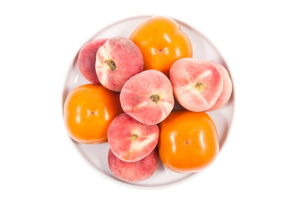 Fresh persimmon and donut peach fruits on a white background photo