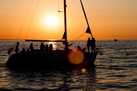 Sailing boat silhouette, sunset, ocean