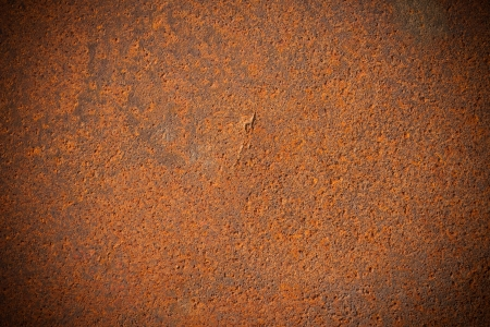 Dark edged old rusty iron metal plate background photo