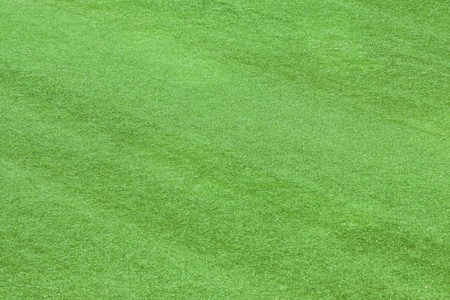 Artificial grass field texture background photo