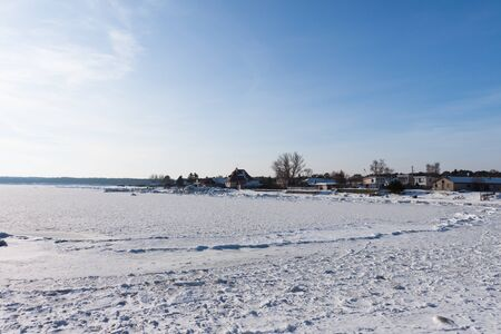 Winter frozen vilage on the coast of Baltic sea photo