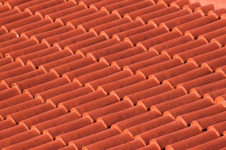 Red painted roof tiles background photo