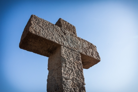 evangelism: Old ston cross over blue sky