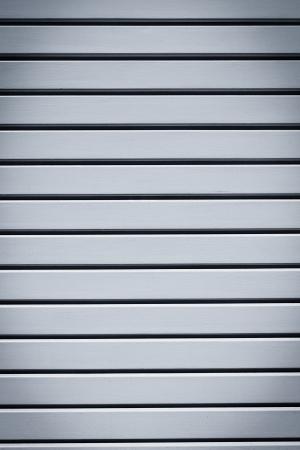 Industrial shiny grey metal door background photo
