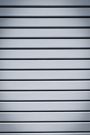 Industrial shiny grey metal door background