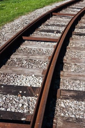 bullhead: Tram rail road track disappearing around a curve in grass