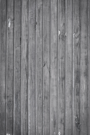Old weathered black and white plank wood wall background