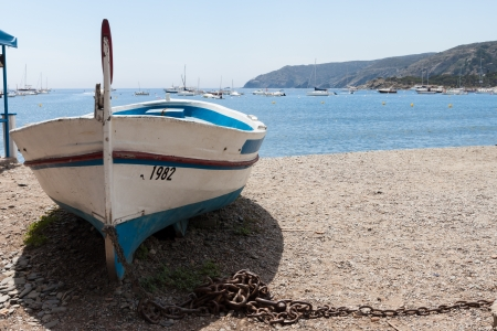 Boat in the beach in Cadaques, Catalonia Spain