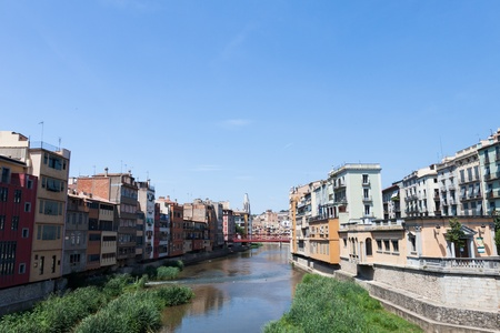 View from the river bridge in Girona old town in Spain photo